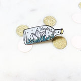 Small wanderlust pin