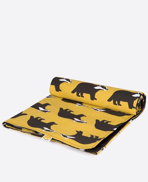 Large anorak kissing badgers picnic blanket unrolling