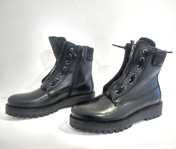 Large eyelet black sparkle tongue leather boot blink