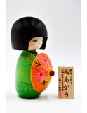 Small kokeshi doll after the rain green ameagari