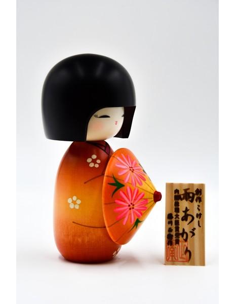 Large kokeshi doll after the rain orange ameagari