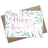 Small palm leaves happy anniversary greeting card