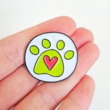 Small paw print pin on hand by angela chick 1024x1024 2x